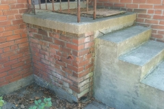 damaged brick porch wall