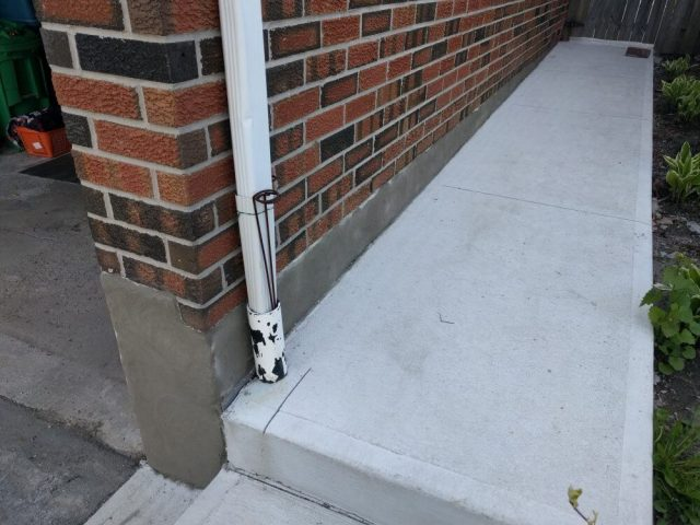 Fresh coat of parging applied to foundation wall